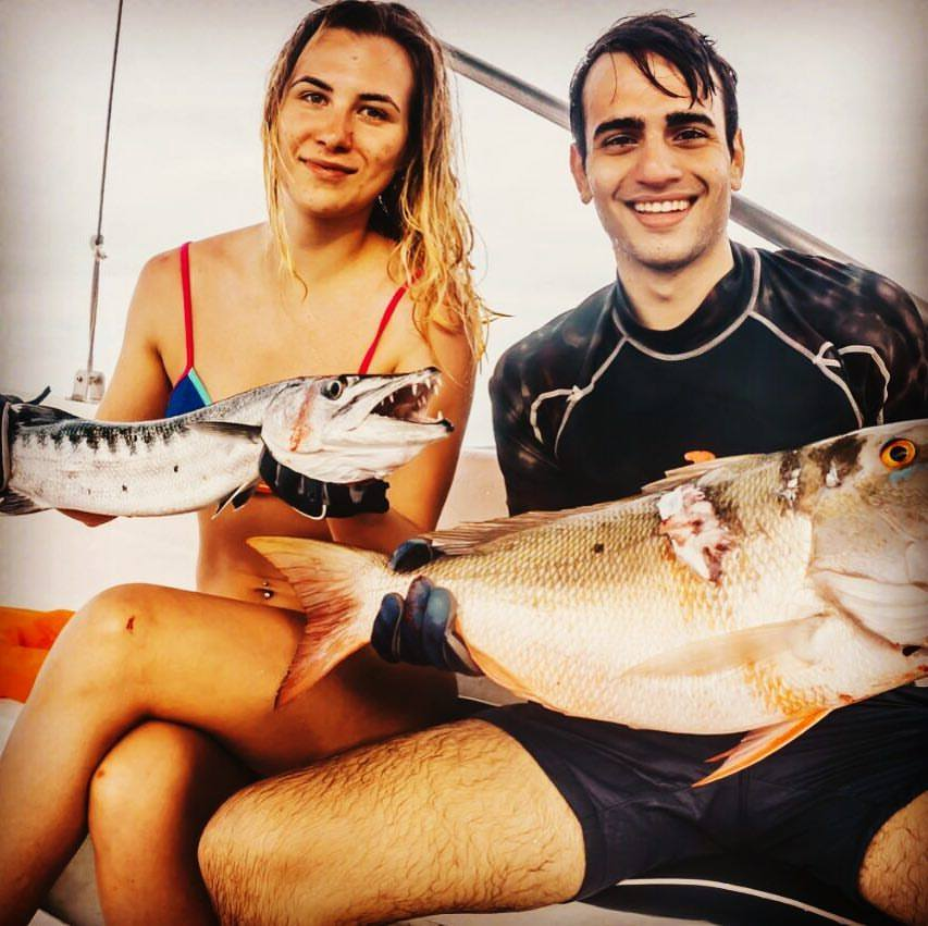 men and woman spearfishing